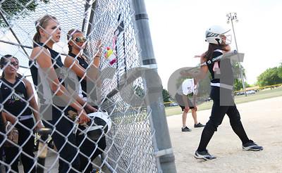 Kyle Bursaw – kbursaw@shawmedia.com  Kishwaukee Valley Storm 18U player Becca Schroeder (4) takes some swings while on deck to bat on Friday, June 22, 2012.