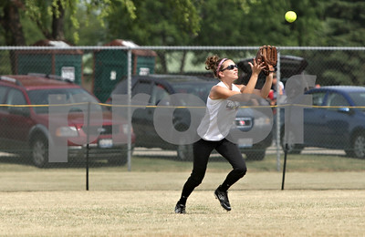 Rob Winner – rwinner@shawmedia.com  Kishwaukee Valley Storm 18u center fielder Laura Turnroth catches a fly ball to end the first inning during a game against Big Dog Heat 18u team at the Storm Dayz tournament in Sycamore Saturday morning.