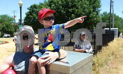 Kyle Bursaw – kbursaw@shawmedia.com  Avery Roewer, 3, points to a Union Pacific retro passenger train going through downtown DeKalb as his father  James Roewer helps keep him steady on a higher vantage point  on the afternoon of Monday, June 25, 2012.
