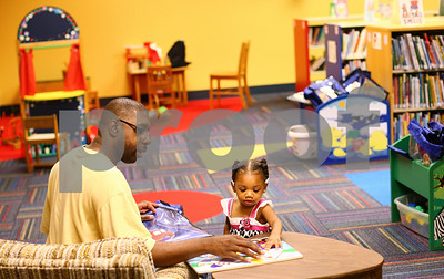 Kyle Bursaw – kbursaw@shawmedia.com  Richard Felker helps his 20-month-old daughter Rayah Felker work on a puzzle in the children's section of the Sycamore Public Library on Wednesday, June 27, 2012. The library recently entered the second of four phases of construction, opening up the newly renovated children's section last Friday.