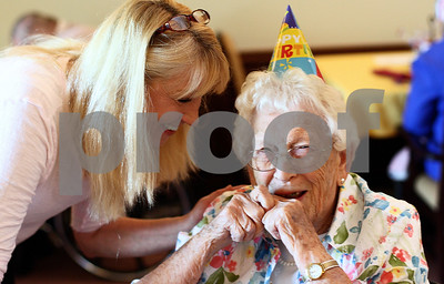 Kyle Bursaw – kbursaw@shawmedia.com  Sharon Fisher (left), the activities director at the Bethany Health Care and Rehab Center, chats with Lucille Larson on her 100th birthday during a lunch celebration at the center on Tuesday, June 26, 2012.