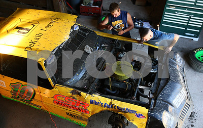 Kyle Bursaw – kbursaw@shawmedia.com  Jordan Jackowiak (left), who is leading the Late Model standings at the Sycamore Speedway, works on his car with his crew chief James Karns in DeKalb, Ill. on Monday, June 25, 2012. Jackowiak finished third last year in his first season at the speedway.