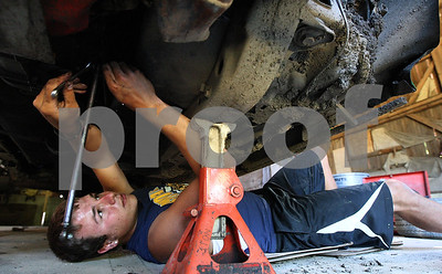 Kyle Bursaw – kbursaw@shawmedia.com  Jordan Jackowiak, who is leading the Late Model standings at the Sycamore Speedway, works on his car in a barn at his father's home in DeKalb, Ill. on Monday, June 25, 2012. He finished third last year in his first season at the speedway.