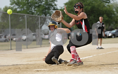 Rob Winner – rwinner@shawmedia.com  Kishwaukee Valley Storm baserunner Stephanie Cartwright (left) scores after a wild pitch in the top of the first inning during a game against Big Dog Heat 18u team at the Storm Dayz tournament in Sycamore Saturday morning.