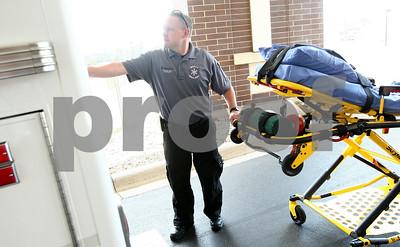 Kyle Bursaw – kbursaw@shawmedia.com  Paramedic Mike Morrison returns a stretcher to an ambulance outside Kishwaukee Community Hospital on Thursday, June 28, 2012.