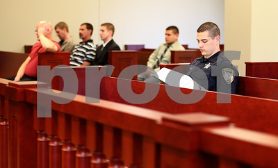 Kyle Bursaw – kbursaw@shawmedia.com  Kris Mecca of the DeKalb Police Department (right) reviews case notes in courtroom 130, a newly opened courtroom in the DeKalb County Courthouse on Monday, June 4, 2012.