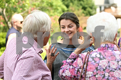 Rob Winner – rwinner@shawmedia.com  Nicoletta Knoble (center) discusses her college plans with long-time family friends Dick and Lois Benson, of Batavia, during a graduation party for Knoble in DeKalb Saturday, May 26, 2012. Knoble, who graduated from Benet Academy in Lisle, will be attending the University of Cambridge in the United Kingdom.