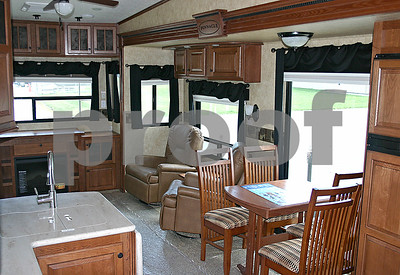 The 2012 Jayco Pinnacle camper has all the comforts of home, including a two-door refridgerator, central vacuum, convection microwave and reclining seats.  By Nicole Weskerna - nweskerna@shawmedia.com