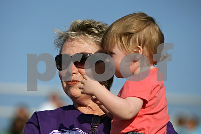 Rob Winner – rwinner@shawmedia.com  Survivor Peggy Brown, of Aurora, holds her one-year-old granddaughter Avery Gage, of Aurora, during the opening ceremony for the Relay for Life event at DeKalb High School Saturday evening.