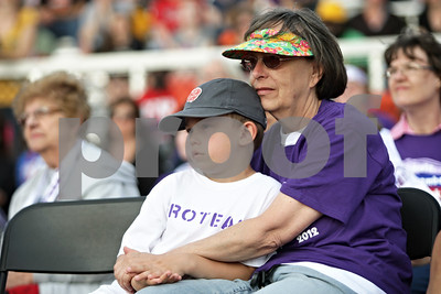 Rob Winner – rwinner@shawmedia.com  Survivors Frank Carpino, 7 of Genoa, and his grandmother Mary Beeman, of Streamwood, listen to speaker Amberley Kowalski (not pictured) during the opening ceremony for the Relay for Life event at DeKalb High School Saturday evening.  ***Confirmed both survivors -Rob***