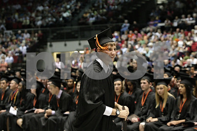 Rob Winner – rwinner@shawmedia.com  Tyler Gosnell heads back to his chair after receiving his diploma during the DeKalb High School graduation ceremony at the Convocation Center Thursday evening.