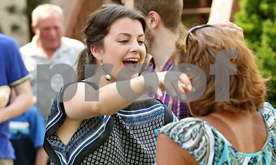Rob Winner – rwinner@shawmedia.com  Nicoletta Knoble (left) embraces long-time family friend Peggy O'Neil, of Sycamore, during a graduation party for Knoble in DeKalb Saturday, May 26, 2012. Knoble, who graduated from Benet Academy in Lisle, will be attending the University of Cambridge in the United Kingdom.