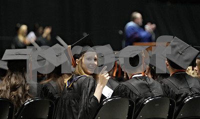 Rob Winner – rwinner@shawmedia.com  McKenna Teboda looks back to the crowd during the 2012 DeKalb High School graduation ceremony at the Convocation Center Thursday evening.
