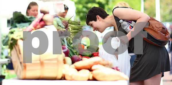 Kyle Bursaw – kbursaw@shawmedia.com  Christine Veverka finds some vegetables at the DeKalb farmer's market on Thursday, June 7, 2012.