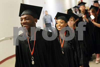 Rob Winner – rwinner@shawmedia.com  Ryan Williams is all smiles as the DeKalb High School graduating class makes their way to the floor of the Convocation Center Thursday evening.