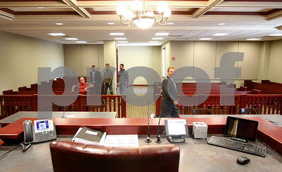 Kyle Bursaw – kbursaw@shawmedia.com  A group of people, including J. Brick Van Der Snick (right), get a first glimpse of courtroom 130, a newly opened courtroom in the DeKalb County Courthouse on Monday, June 4, 2012.