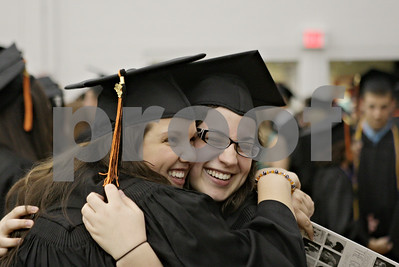 Rob Winner – rwinner@shawmedia.com  Suzie Geisler (left) hugs Caitlin Gordon before the DeKalb High School graduation ceremony at the Convocation Center Thursday evening.