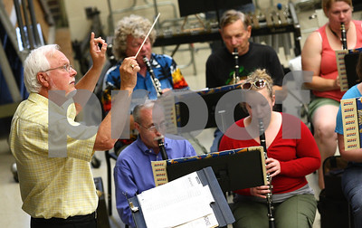 Kyle Bursaw – kbursaw@shawmedia.com  Gene Montgomery leads the DeKalb Municipal Band's rehearsal on Monday, June 4, 2012. Montgomery is serving as interim director of the band until a permanent replacement is found.