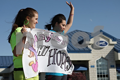 Rob Winner - rwinner@shawmedia.com  Destani Maldonado (left) and Nina Cuevas, both 14 of Sycamore, hold up a sign for Relay for Life team Hayley's Hi Hopes outside Culver's in Sycamore Tuesday. The team, led by Hayley Foord, has raised over $3,000 for this weekend's Relay for Life event.