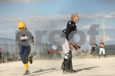 Rob Winner – rwinner@shawmedia.com  Sterling baserunner MeKenna Pearson scores as Kaneland catcher McKinzie Mangers calls for the ball in the top of the seventh inning during a Class 3A Belvidere North Sectional semifinal Wednesday, May 30, 2012. Sterling defeated Kaneland, 9-1.