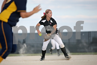 Rob Winner – rwinner@shawmedia.com  Kaneland pitcher Delani Vest fields a ground ball before throwing to first for the final out in the top of the seventh inning during a Class 3A Belvidere North Sectional semifinal Wednesday, May 30, 2012. Sterling defeated Kaneland, 9-1.