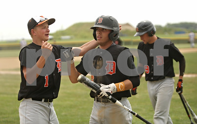 Rob Winner – rwinner@shawmedia.com  DeKalb's Nick Bourdages (left) greets teammate Kevin Sullivan after Sullivan scored a run in the top of the third inning  during the Class 3A Kaneland Regional final in Maple Park Saturday afternoon. Marmion Academy defeated DeKalb, 4-1.
