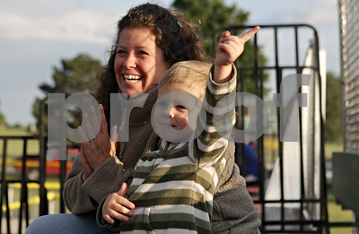 Rob Winner – rwinner@shawmedia.com  During the first inning of the DeKalb County Liners season opener, Tia Anderson and her son Aiden Anderson, 4, cheer for the home team after an out was recorded. This was the Anderson family's first Liners game they have attended.