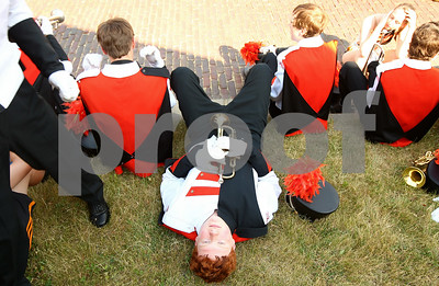 Kyle Bursaw – kbursaw@shawmedia.com  Trumpet player Micah Fagerstrom takes a moment to lay in the grass before the DeKalb marching band played in DeKalb parade on Monday, May 28, 2012.