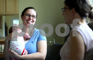 Kyle Bursaw – kbursaw@shawmedia.com  Chrissy Deming, holding her two-week-old daughter Abby, chats with doula Kim Wheaton during a follow-up appointment about how things have gone since Deming was in labor at Deming's DeKalb home on Friday, May 25, 2012.