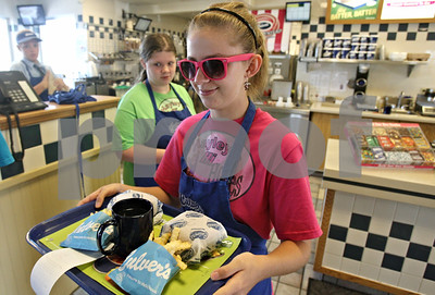 Rob Winner – rwinner@shawmedia.com  Hayley Foord (front) and Rebecca Hungerford, both 14 of Sycamore, carry trays of food to customers dining at Culver's in Sycamore Tuesday evening. Foord is raising money for this weekend's Relay for Life event. Culver's agreed to donate 10% of their profits to Foord's team, Hayley's Hi Hopes, during a three-hour span Tuesday night.