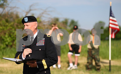 Kyle Bursaw – kbursaw@shawmedia.com  Brigadier General Steven P. Huber speaks to the crowd at the Memorial Day ceremony near Joiner Cemetary on Monday, May 28, 2012.