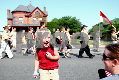 Kyle Bursaw – kbursaw@shawmedia.com  Ayden Roland, 5, reacts as he returns to the curb with two fistfuls of candy thrown out from people marching in DeKalb's Memorial Day parade on Monday, May 28, 2012.