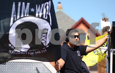 Kyle Bursaw – kbursaw@shawmedia.com  Caleb Meyers, of the Cortland Fire Department, waves a POW-MIA flag while riding on one of Cortland's fire trucks in DeKalb's Memorial Day parade on Monday, May 28, 2012.