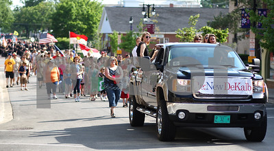 Kyle Bursaw – kbursaw@shawmedia.com  Various groups in the parade including Re:New DeKalb (front) make their way to Lincoln Highway for the DeKalb Memorial Day parade on Monday, May 28, 2012.