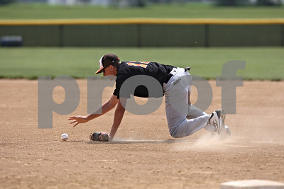 Rob Winner – rwinner@shawmedia.com  After knocking down a ground ball, DeKalb first baseman Matt Hoyle picks up the ball before throwing to first for an out in the bottom of the first inning during the Class 3A Kaneland Regional final in Maple Park Saturday afternoon. Marmion Academy defeated DeKalb, 4-1.