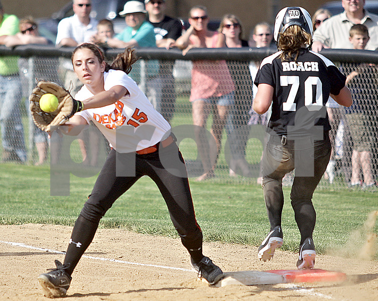 Monica Maschak - mmaschak@shawmedia.com<br /> Hannah Walther, for DeKalb, reaches to catch the ball in an attempt to get Kaneland's Lexi Roach out at first base in a game at Kaneland High School on Thursday, May 16, 2013. The Knights shut out the Barbs 4-0.