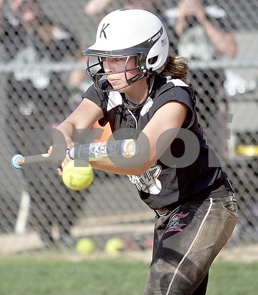 Monica Maschak - mmaschak@shawmedia.com<br /> Lexi Roach bunts the ball in a game against DeKalb on Thursday, May 16, 2013. The Knights shut out the Barbs 4-0.