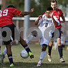 Rob Winner – rwinner@shawmedia.com<br /> <br /> Keith's Shubham Chahar (19) and Hiawatha's Poncho Garcia (8) look to control a ball during the first half in Kirkland Tuesday. Keith defeated Hiawatha, 2-1.