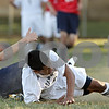 Rob Winner – rwinner@shawmedia.com<br /> <br /> Hiawatha's Poncho Garcia (right) goes to the ground after his shot was blocked by Keith's Dakota Schmidt (left) during the second half in Kirkland Tuesday. Keith defeated Hiawatha, 2-1.