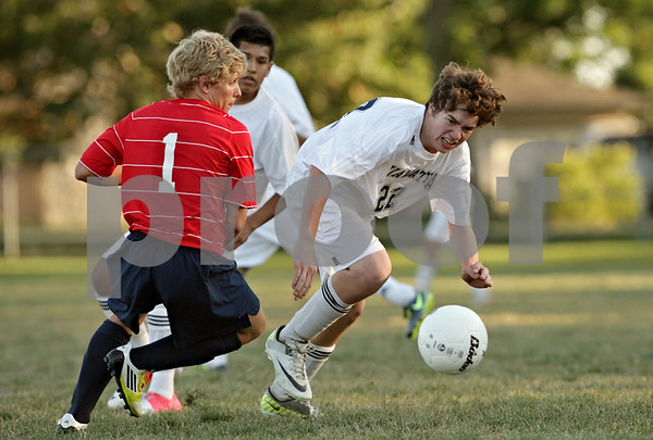 Rob Winner – rwinner@shawmedia.com<br /> <br /> Keith's Tom Stott (1) and Hiawatha's Gage Grant struggle for possession of a ball during the second half in Kirkland Tuesday. Keith defeated Hiawatha, 2-1.