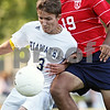 Rob Winner – rwinner@shawmedia.com<br /> <br /> Hiawatha's Marek Mlodzianowski (3) and Keith's Shubham Chahar (19) struggle for possession during the first half in Kirkland Tuesday. Keith defeated Hiawatha, 2-1.