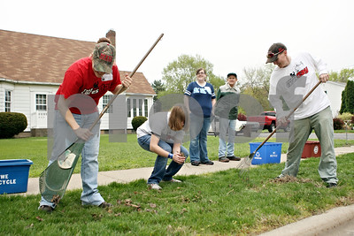 Rob Winner – rwinner@shawmedia.com  Northern Illinois University Cares Day volunteers including Jackie Owensby (from left), Lauren Robak, Kayla Shick and Randy Bergman help clean up Dave Miner's (second from right) front yard Saturday, April 14, in DeKalb. Miner injured his shoulder five years ago and appreciated the volunteers' help.