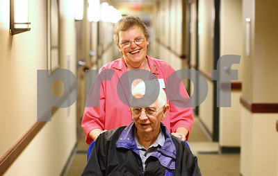 Kyle Bursaw – kbursaw@shawmedia.com  Pat Bute chats with patient Burly Billips while pushing him to his destination in Kishwaukee Community Hospital on Wednesday, May 9, 2012. Bute has been volunteering at the hospital for about a year and half.