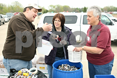 Rob Winner – rwinner@shawmedia.com  (From left to right) Greg Maurice, Chris Bagby, and Christel Springmire sort batteries dropped off during a DeKalb electronics recycling event Saturday, April 14.