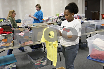 Rob Winner – rwinner@shawmedia.com  Northern Illinois University graduate student Joy Mitchell (right) helps sort clothing while volunteering for NIU Cares Day at Feed'em Soup in DeKalb Saturday, April 14.