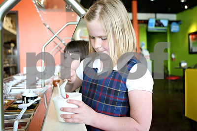 Rob Winner – rwinner@shawmedia.com  Jillian Keck (front), 9, and sister Kaitlynn Keck, 7, choose toppings for their frozen yogurt during a visit to Aspen Leaf Yogurt in DeKalb Friday afternoon.The self-serve frozen yogurt shop opened in February.  Friday, May 4, 2012 DeKalb, Ill.