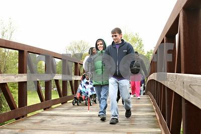 Rob Winner – rwinner@shawmedia.com  Cody Marbutt (left), 16, walks with his father, Mickey, while participating in the March for Babies event which kicked off at Hopkins Park in DeKalb Saturday morning. The Marbutt family was the Ambassador Family for the DeKalb County 2008 March for Babies.