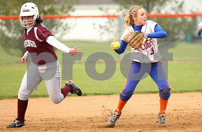 Kyle Bursaw – kbursaw@shawmedia.com  Genoa-Kingston's Natalie Klein throws to first base during the first inning of the Cogs 7-5 loss to Marengo in Genoa, Ill. on Tuesday, May 1, 2012.