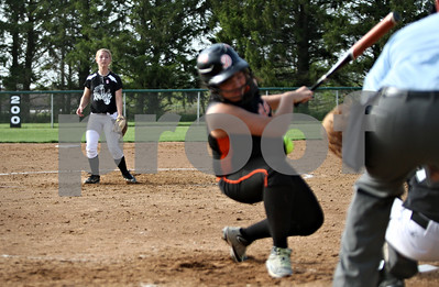 Rob Winner – rwinner@shawmedia.com  Kaneland pitcher Delani Vest (left) hits DeKalb batter Payton Marten during the top of the third inning in Maple Park, Ill., Wednesday, May 2, 2012. Kaneland defeated DeKalb, 7-4.