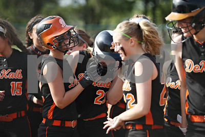 Rob Winner – rwinner@shawmedia.com  DeKalb batter Sarah Friedlund (23) is mobbed at home plate after hitting a two-run home run during the top of the third inning in Maple Park, Ill., Wednesday, May 2, 2012. Kaneland defeated DeKalb, 7-4.